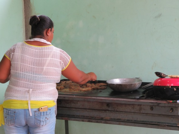 One of the mamas cooking lunch for us