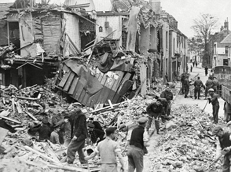 World War Ii: Britain: Air Raids: South East England: Canterbury. Troops And Civilian Workers Clear Up Debris In A Canterbury Street. 2 November 1942